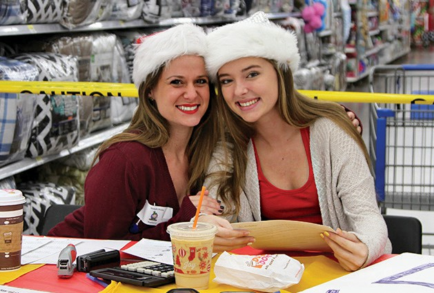 The elves helping at The Joy of Giving